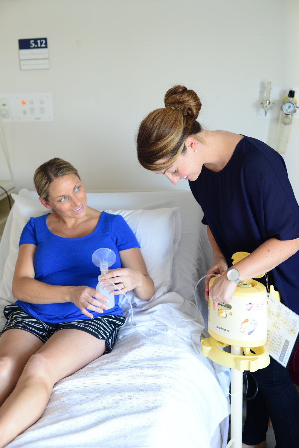 Melissa learning how to use a breast pump when her milk had come in (three days post natal).
