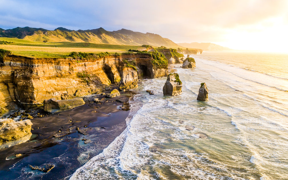tongaporutu-beach-new-zealand-coast-north-island-nz-new-plymouth-three-sisters-sunset-aerial.jpg