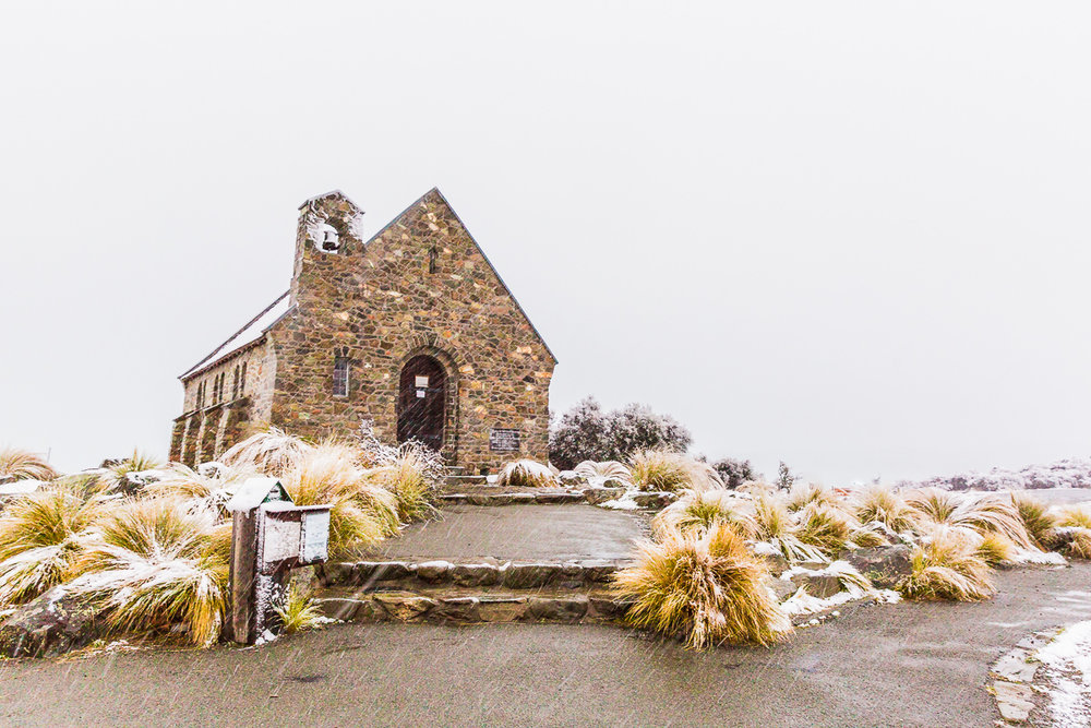 snow-snowing-lake-tekapo-church-good-shepherd-south-island-storm-autumn-landscape.jpg