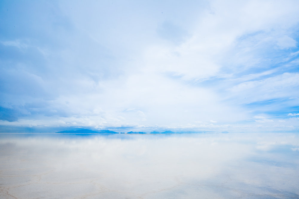 photography-uyuni-salt-flat-salar-de-uyuni-bolivia-potosi-rain-reflection-reflected-sky-blue-white.jpg