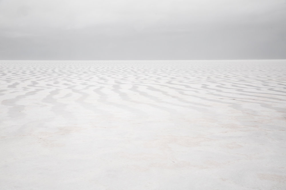 white-salar-de-uyuni-salt-flat-storm-thunderstorm-rain-flooded-wet-ground-bolivia-travel-photography-photos.jpg
