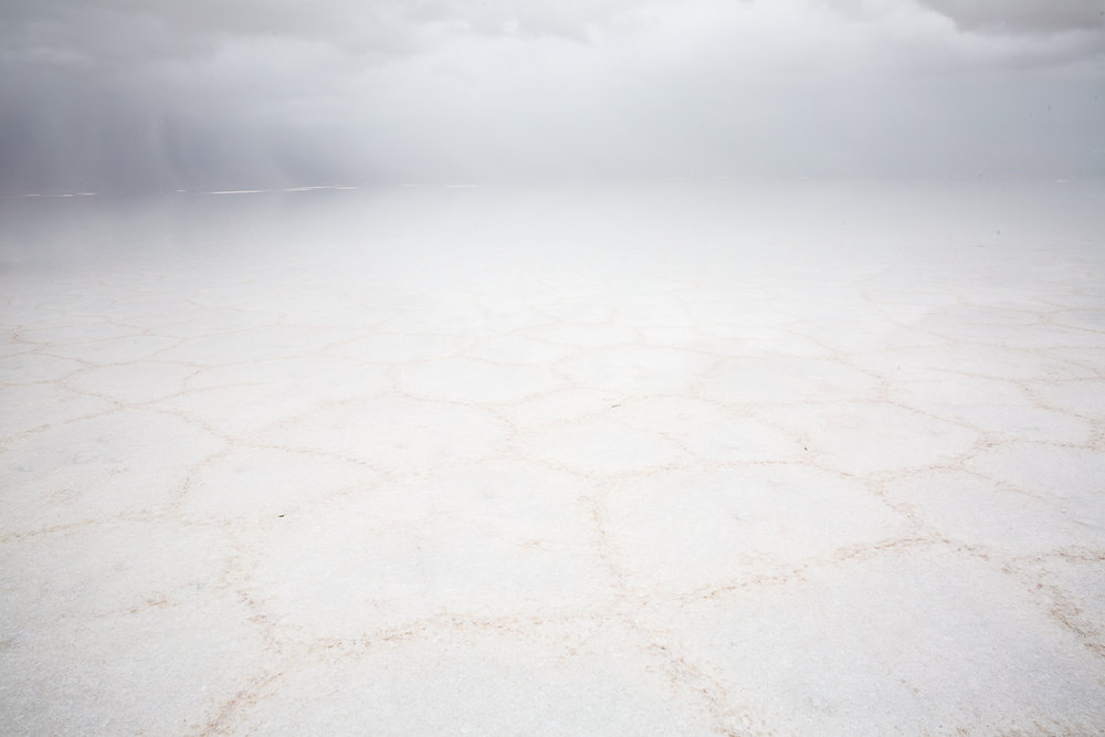 white-salt-flats-salar-de-uyuni-potosi-storm-rain-water-wet-flooded-flat-rainy-grey-cloudy-photography-photos.jpg