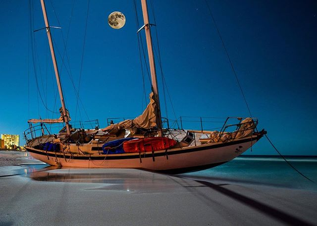 Lunar Landing.  Reposting this image I took it down to make a slight edit to it.  #okaloosaisland #sailboat #miramar #jakewooleyphotography #instagood #florida #photography #longexposure_shots #phantom #aqua #destin #crashed #sowal #beaches #moon #ocean #fortwaltonbeach #panamacitybeach #nikon #compostion #summer #break #moonlight #stars #sanddestin