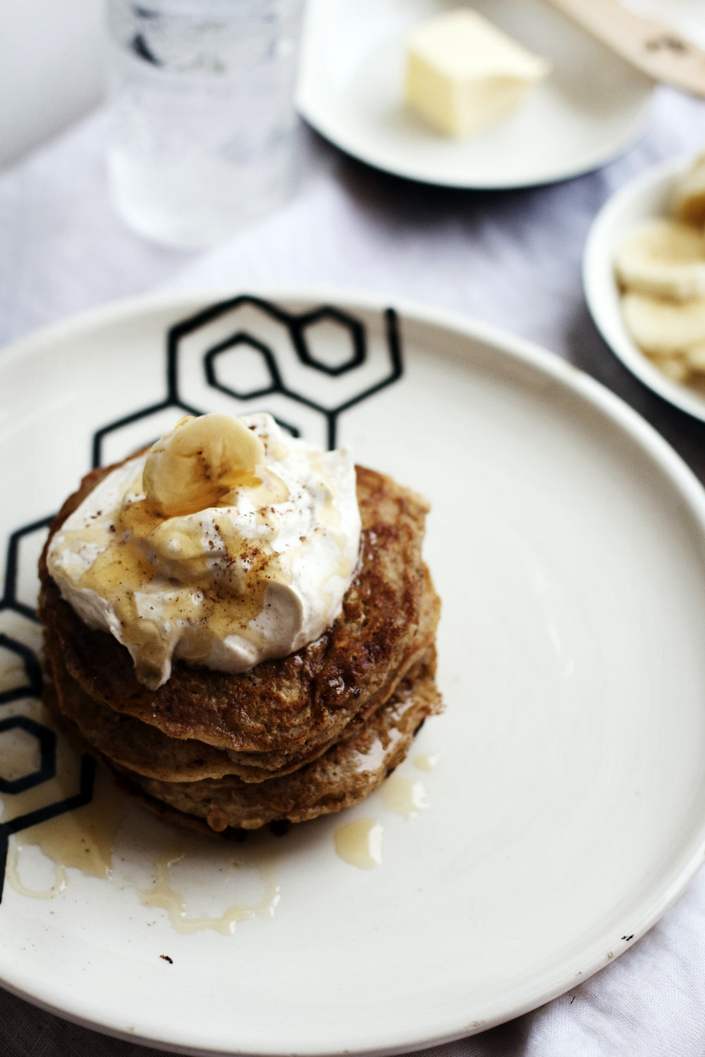 Brown Butter Banana Oatmeal Pancakes w/ Peanut Butter Whipped Cream + Honey (gluten-free + refined sugar free) | Ruby Josephine