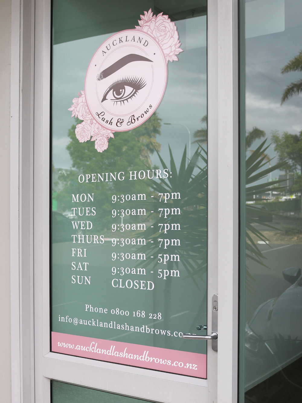Front door signage designed by  Design by Cheyney . Printed and applied by  Speedy Signs