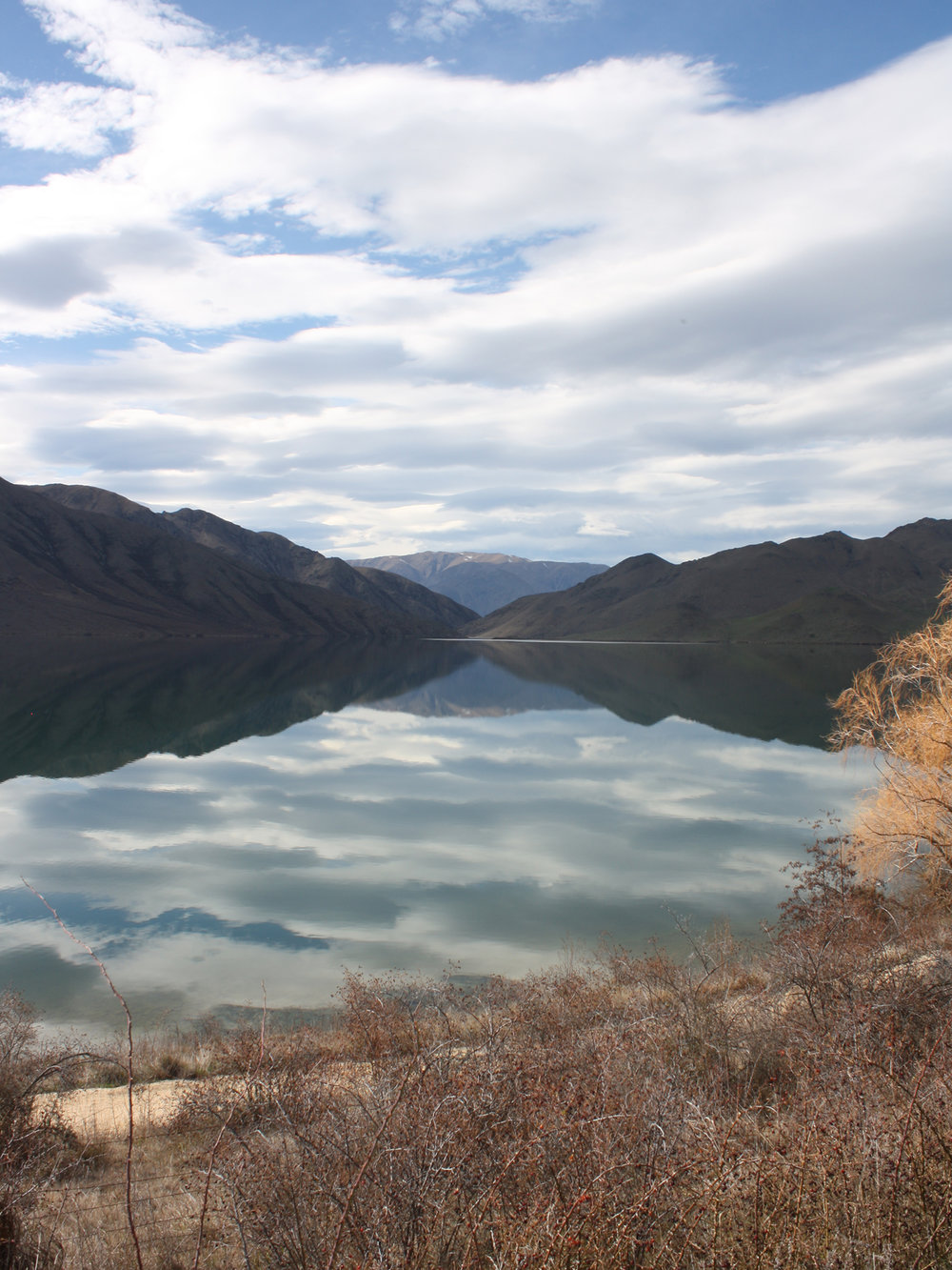 Mirrored landscape. Somewhere between Oamaru and Queenstown on our South Island road trip, New Zealand