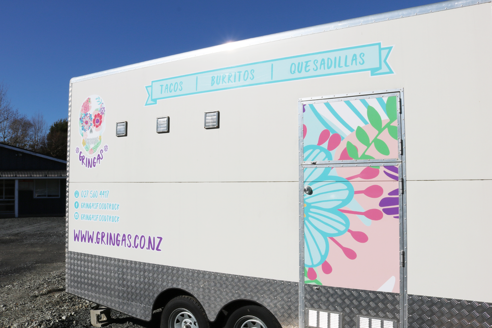 The back of the truck. Artwork by Design by Cheyney, printed by  Speedy Signs Whangarei .