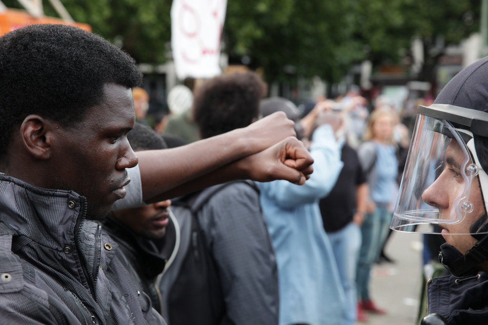 "More unrest at Oranienplatz as one refugee threatens to set himself on fire. Mohammed (not pictured) from Niger shouted ""just take out your guns and shoot all of us! We have survived the NATO bombing in Libya! We survived the sea! But what a fucking stupid life, for three years on the streets of Europe, no job, no nothing."" 2014."
