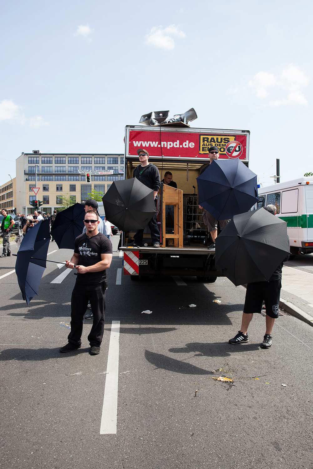 "An NPD demonstration in Hellersdorf takes defensive action after it came under attack from eggs and flying plastic gloves filled with urine. Germany's far right party was demonstrating against the asylum seekers planned settlement in Hellersdorf, Berlin. Instead, suggesting they be placed in ghettos ""far out"" from the city, 2013"