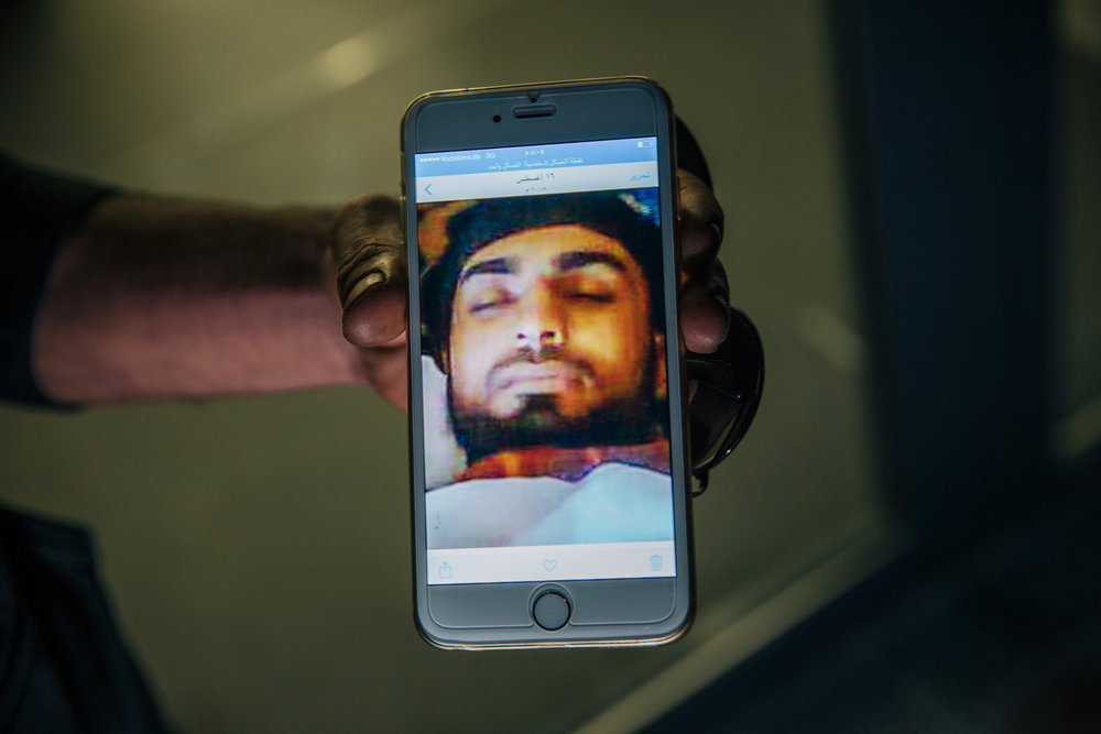 """""""This image was the background of my old phone, but I don't know how to put it on this new one that my mother just gave me. I had two brothers and now they are both dead. This one was always supporting me in life, he was killed by ISIS, the other by Assad"""""""