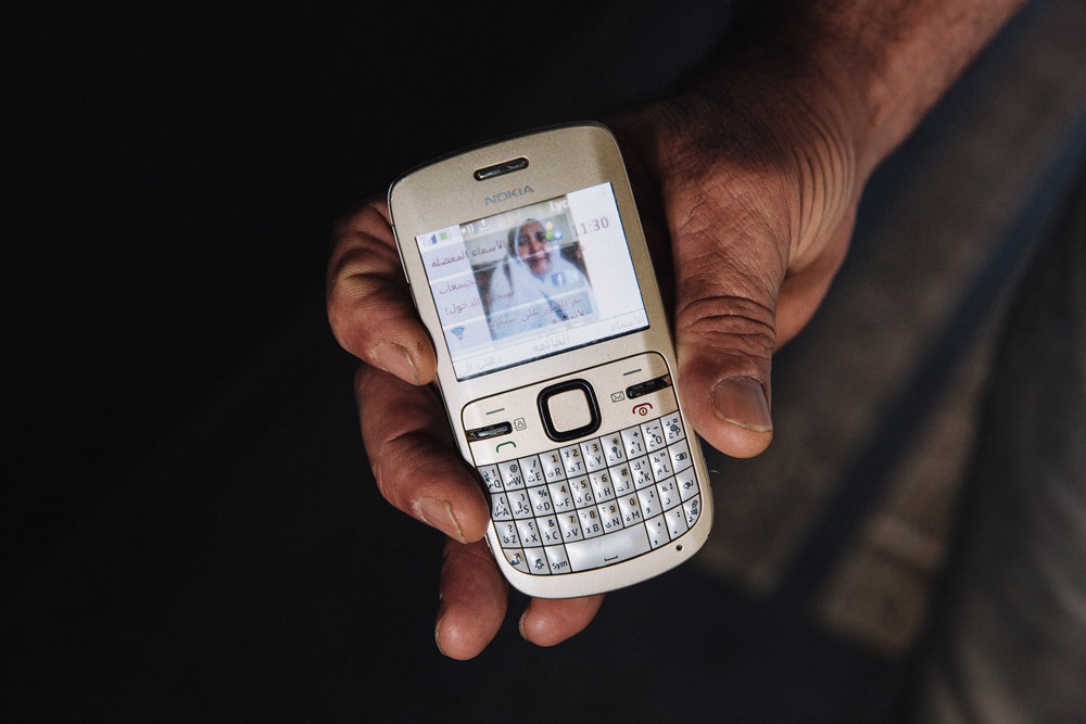 """""""This is a photograph of the mother of my wife, she was killed by ISIS in Libya. I've had this phone for 10 years, I only use it for essential things"""""""