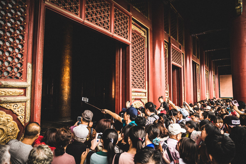 ...and pressed into the crowds for a glimpse of an Emperor's throne