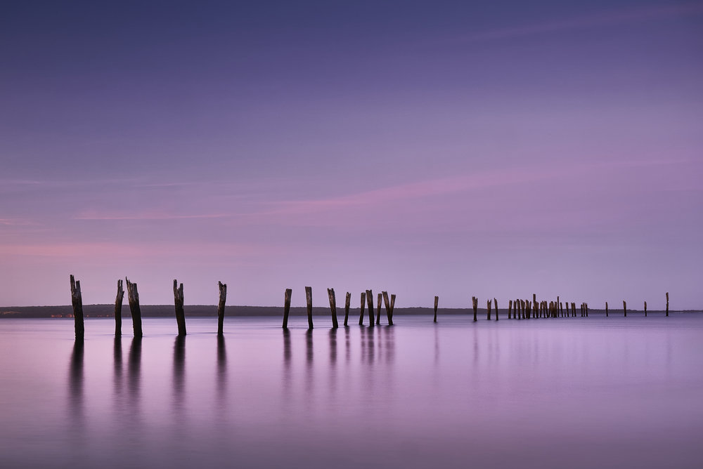 Pylons in Western Port Bay, imbued with a tranquil sense of fading light. This image is displayed at Maitland International Salon of Photography 2019 for the month of Feb/Mar.