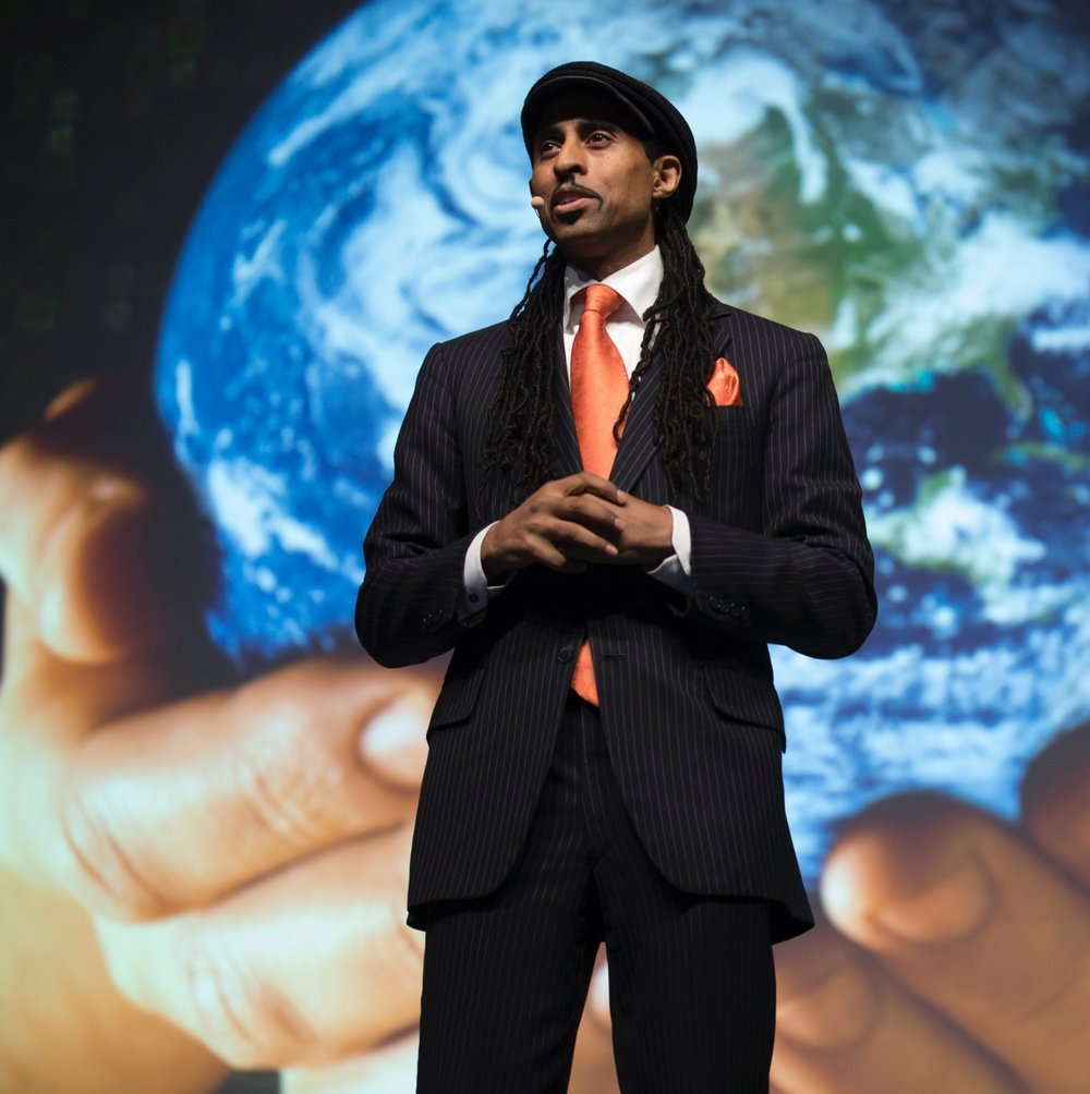 Mustafa Santiago Ali - Mustafa Santiago Ali joined Hip Hop Caucus after working 24 years at the U.S. Environmental Protection Agency (EPA), where he most recently served as Senior Advisor for Environmental Justice and Community Revitalization to Administrator Gina McCarthy and Administrator Lisa Jackson. Mr. Ali specializes in social and environmental justice issues and is focused on a utilizing a holistic approach to revitalizing vulnerable communities. As a renowned speaker, policy maker, community liaison, trainer, and facilitator, he has worked with over 500 domestic and international communities to improve people's lives by addressing environmental, health, and economic justice issues.