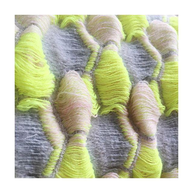 Woven textile sample, close up.