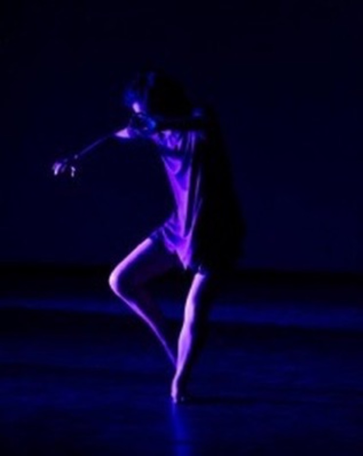 Deneka performing in one of her college dance shows