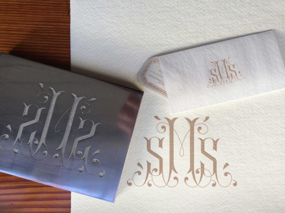Half inch thick steel die hand engraved with bespoke monogram. Hand made, 15% linen/85% cotton fold-over note, 100% cotton calling cards, 100% Italian linen dinner napkins, and custom, die cut and engraved address label.