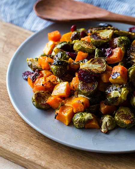 Roasted Brussel Sprouts and Squash with Dried Cramberries and Dijon Vinaigrette via A Beautiful Plate