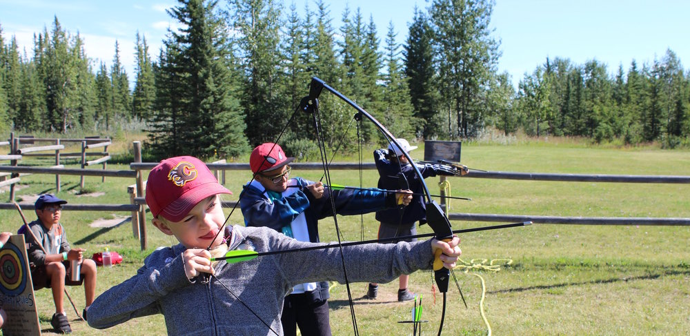 Summer campers participating in archery