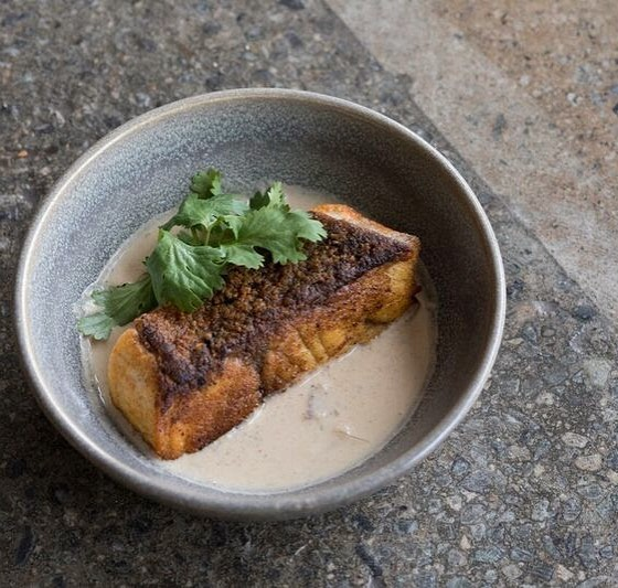 "SOUTH INDIAN FISH MOILEE. barramundi seared crisp with seasoned flour, served atop a coconut ''moilee"" curry spiced with mustard seed curry leaf & serrano chili. #BADMAASH #BADMAASHLA #indianfood 📸 @dylanandjeni"