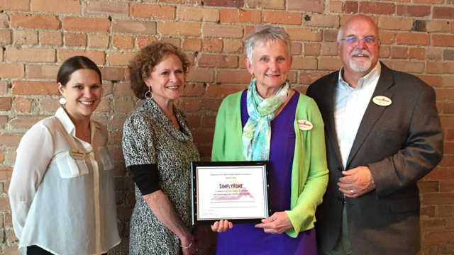 Simply Home team members Amanda, Deborah, Drue, and Allen pose with the 2016 Sky High Growth Award.