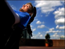Brian relaxes in his wheelchair under a blue sky. Source: www.briankeefer.org