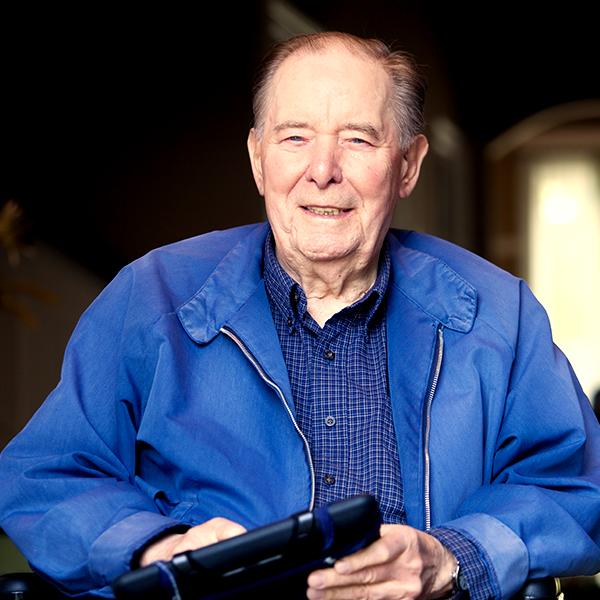 Senior adult man holding a tablet.png