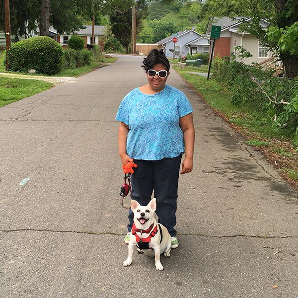 Anissa walks her dog in her neighborhood