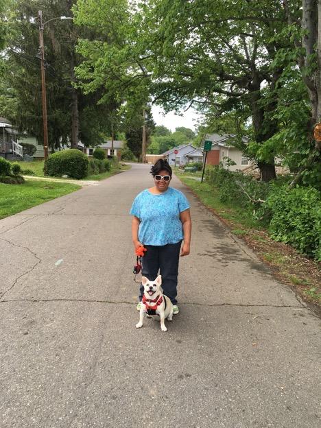 Anissa walks her dog in her neighborhood.jpg