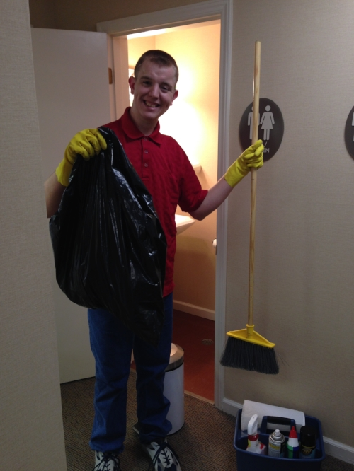 Bryan shows off his cleaning supplies.