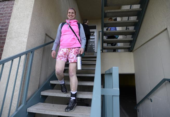 Sophia walks down the stairs, headed to her basketball practice. Sophia is living independently in the community through the Tuneberg Remote Supports Project, which uses technology customized by  Simply Home.