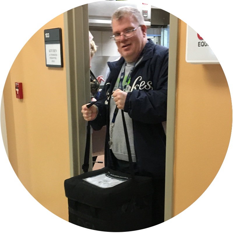 Steve walks through a door with his bag.