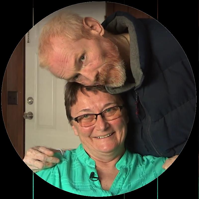 Carl hugs Susan, the program director.