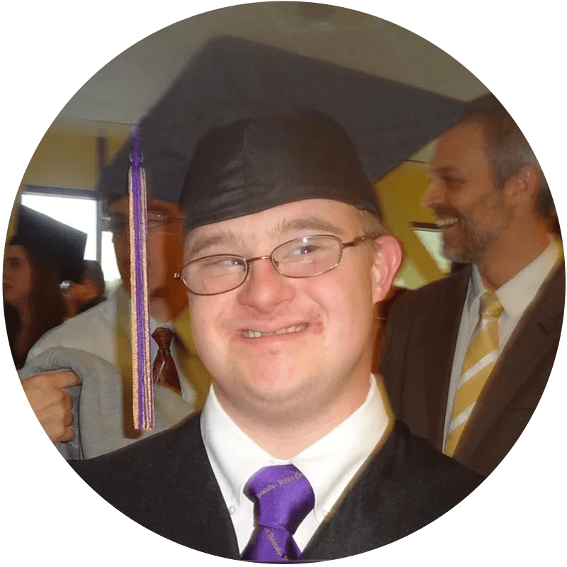 David wears his cap and gown.png