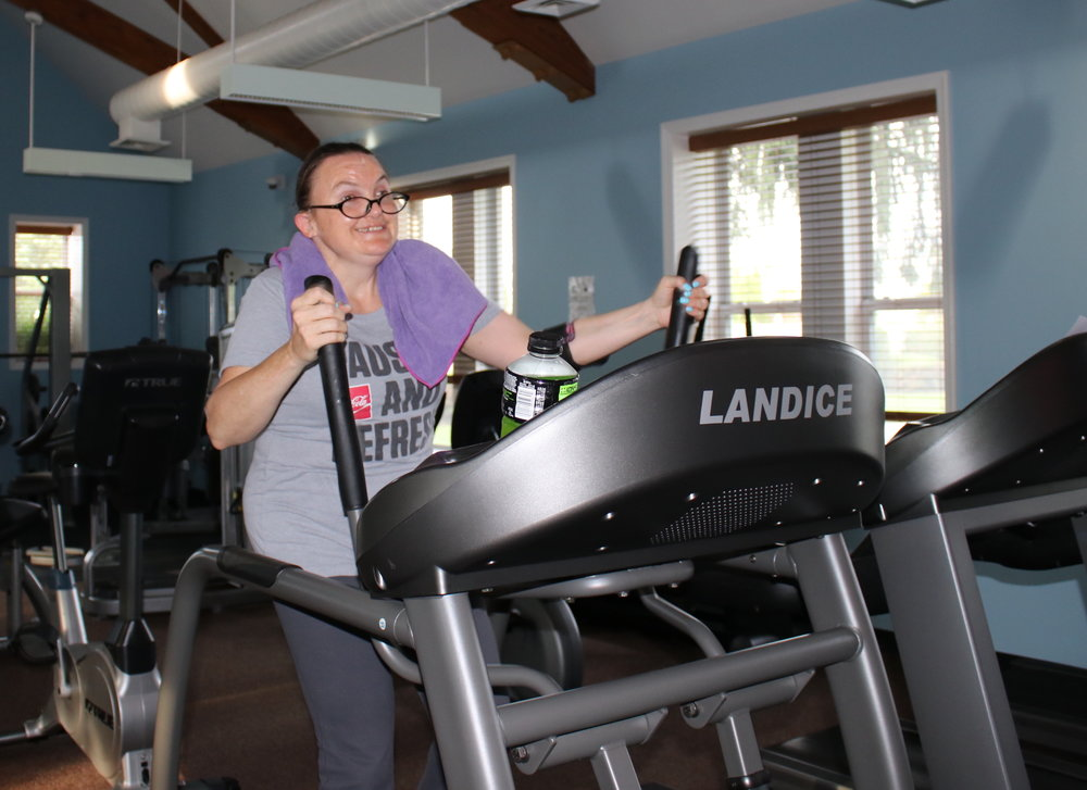Colleen works out at the gym. Exercise is a favorite activity for Colleen.