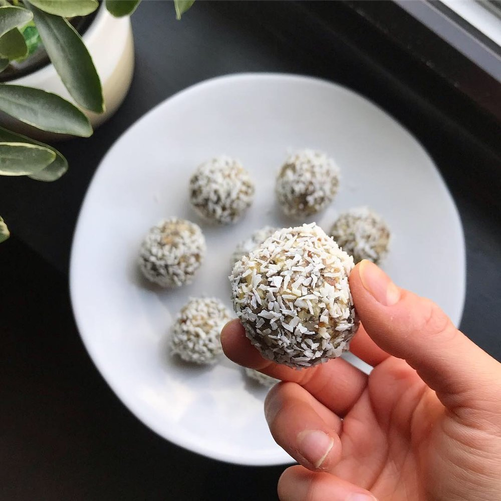 Step 5: With wet hands, roll into little balls. Roll each ball in additional shredded coconut.