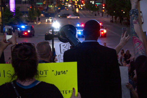 "DENVERITE ""Hundreds of protestors marched peacefully through Downtown Denver Thursday night to demand justice for the victims of police killings."""