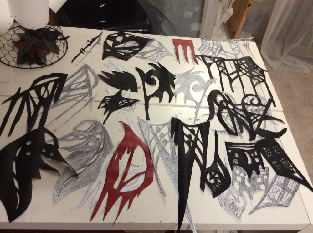 Image of Denenge's studio with elaborately cut pieces of black, red, and white paper as part of work in progress. Image courtesy of artist.