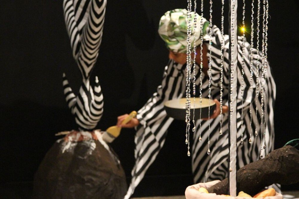 """D. Denenge Duyst-Akpem, image of performance and installation of """"Wan Chuku and the Mystical Yam Farm,"""" 2015. Image credit: Casey Pankey and Oklahoma State University Museum of Art."""