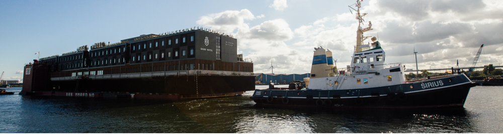 Floating Good Hotel being transported to London