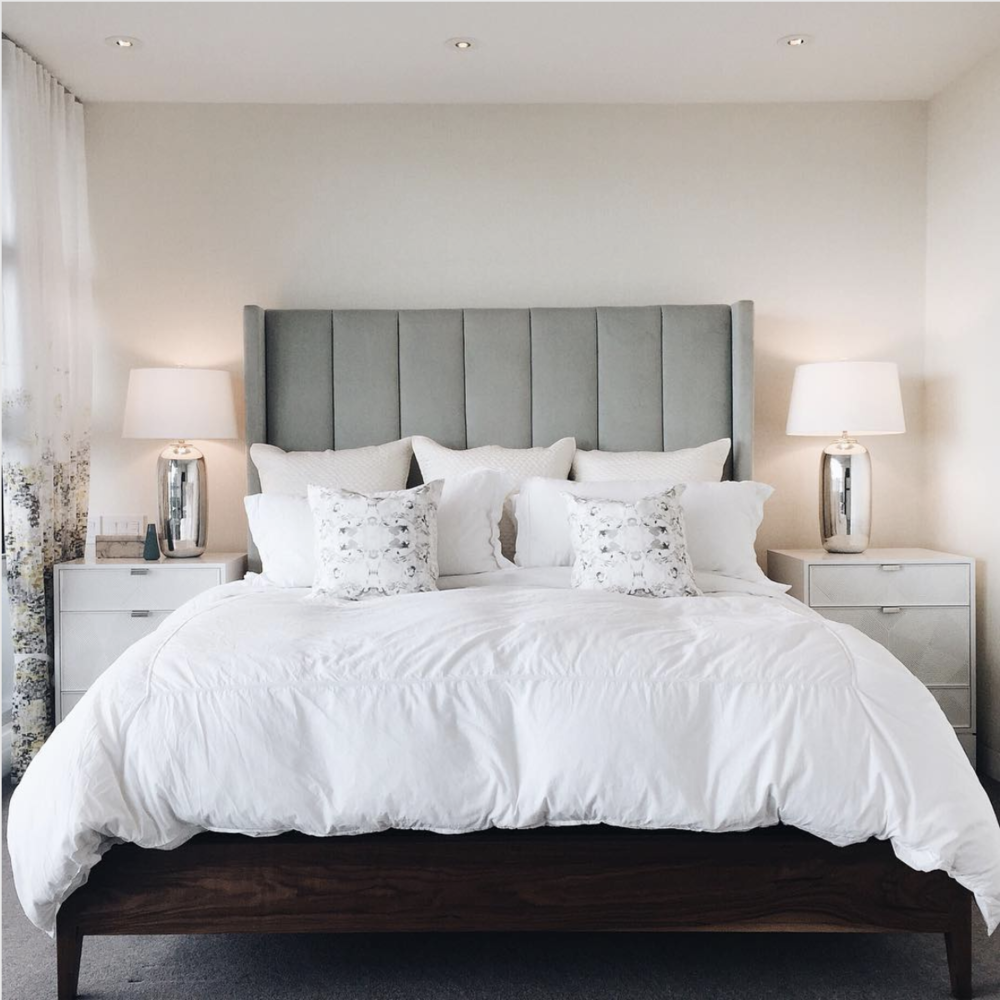 The height of this headboard plus the channel tufting detail makes a grand statement in our West Vancouver modern home. Via:  Nyla Free Designs Instagram