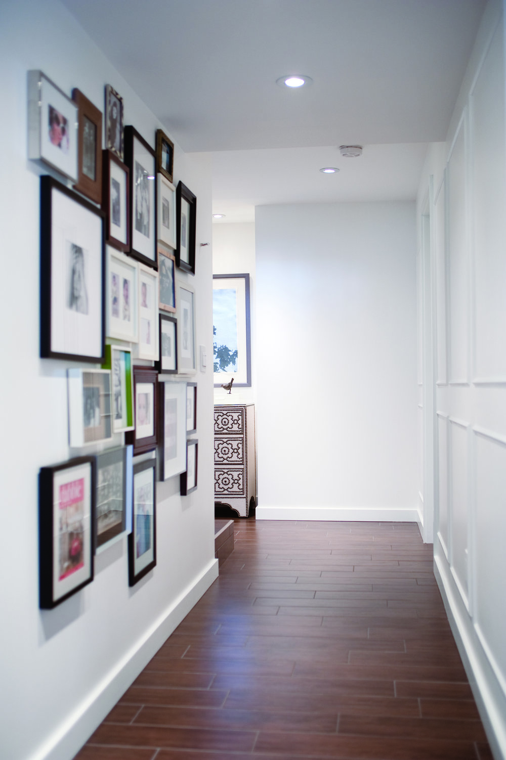Hallway Gallery Wall, Nyla Free Designs, Calgary Interior Designer, Photo: Jared Sych