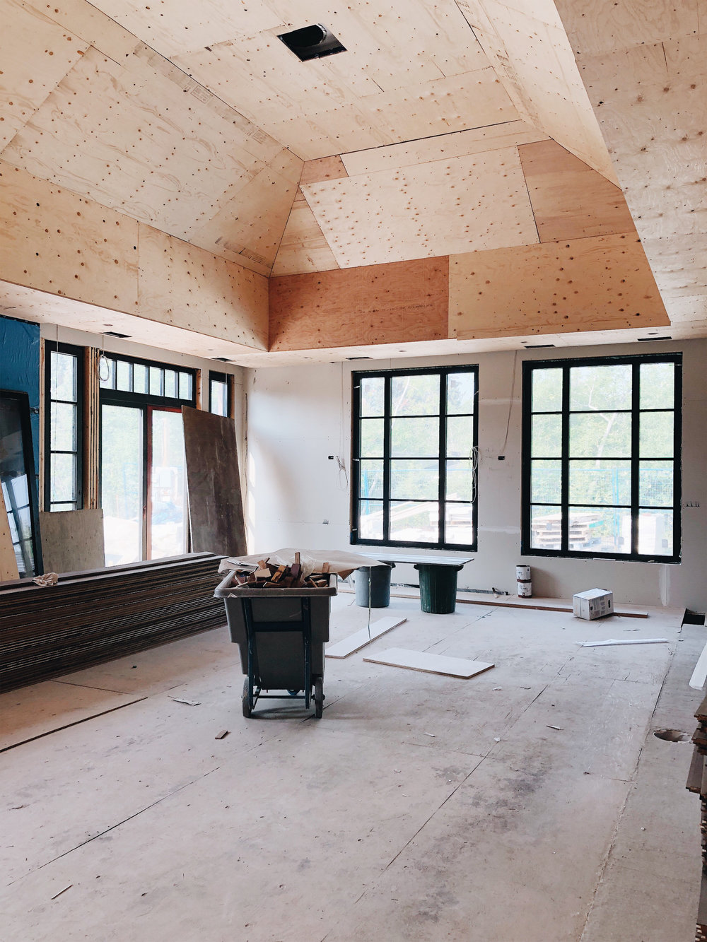 Plywood is installed on the ceiling in preparation for a wood ceiling.