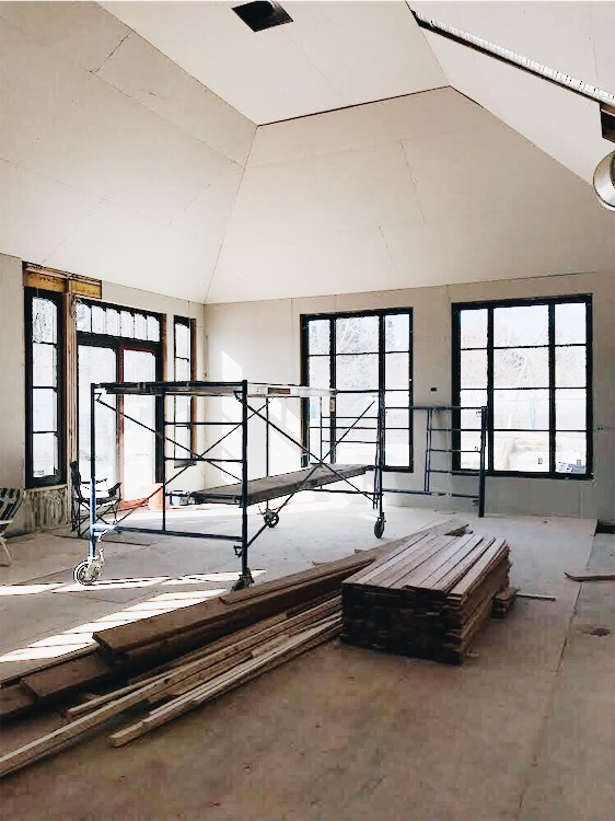 Windows are in and the space is drywalled.