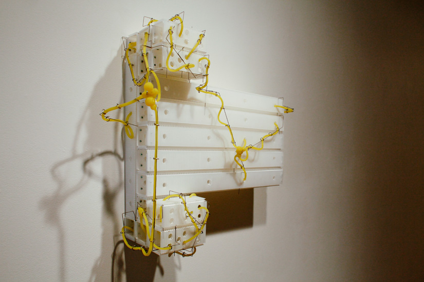 "Circuit , 2009 corrugated plastic, stainless steel wire, silicone rubber  26"" x 28 "" x 9 """