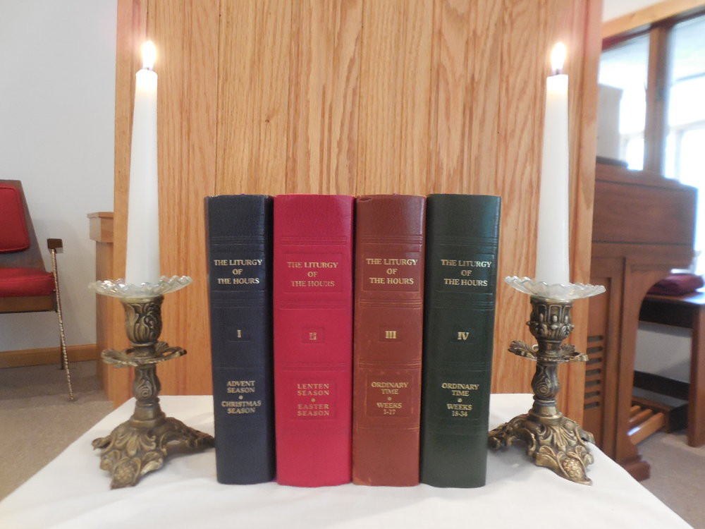 THE FOUR VOLUME SET OF THE LITURGY OF THE HOURS CONTAINING THE SACRED PSALMS AND TEXTs OF THE centuries old DAILY PRAYER OF THE CHURCH