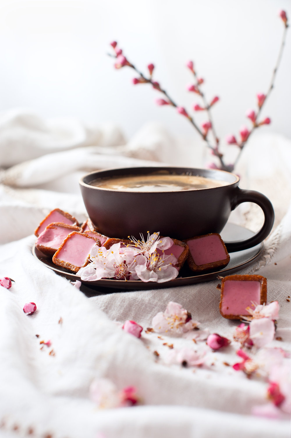 stock-photo-cup-of-coffee-with-cherry-blossom-131304704.jpg