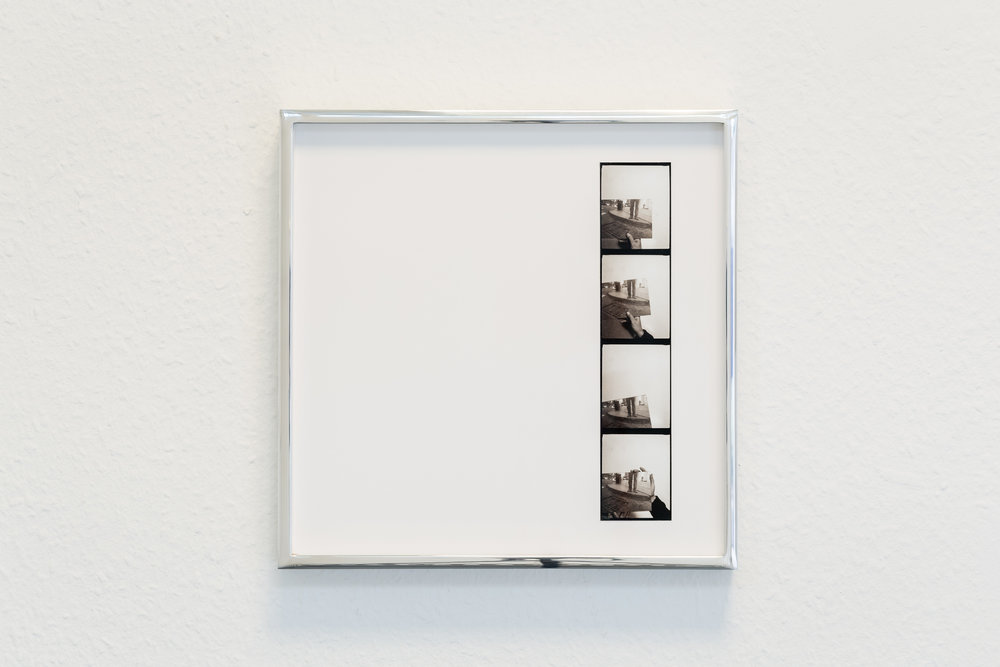 Vittorio Santoro,  Four Speakers' Corners, I , 2014, four photo booth stripes, each framed in a welded aluminum frame (25x25 cm), silver-grey adhesive tape on floor. Dimensions vary with installation  Photo: Kilian Bannwart