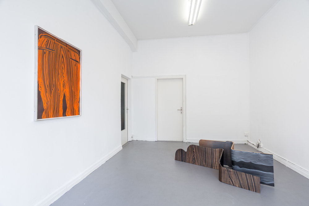 Left: Fiona Banner,  Pinstripe Bum Face,  2015, graphite, vinyl, fluorescent paper, framed, 98.7 x 70 cm Right: Fiona Banner,  Spooning Chairs,  2015, graphite, vinyl, plywood, chair base, 144 x 52 x 36 cm; 158 x 46 x 51 cm Photo: Kilian Bannwart
