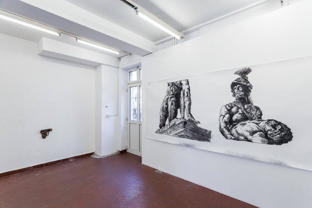 Left: Peter Voss-Knude,  Male Version of a Sport Bra , 2014, cast bronze, 26 x 27 x 4 cm Right: Peter Voss-Knude,  One Statue, Two Eyes , 2017, charcoal on paper, 150 x 360 cm Photo: Kilian Bannwart